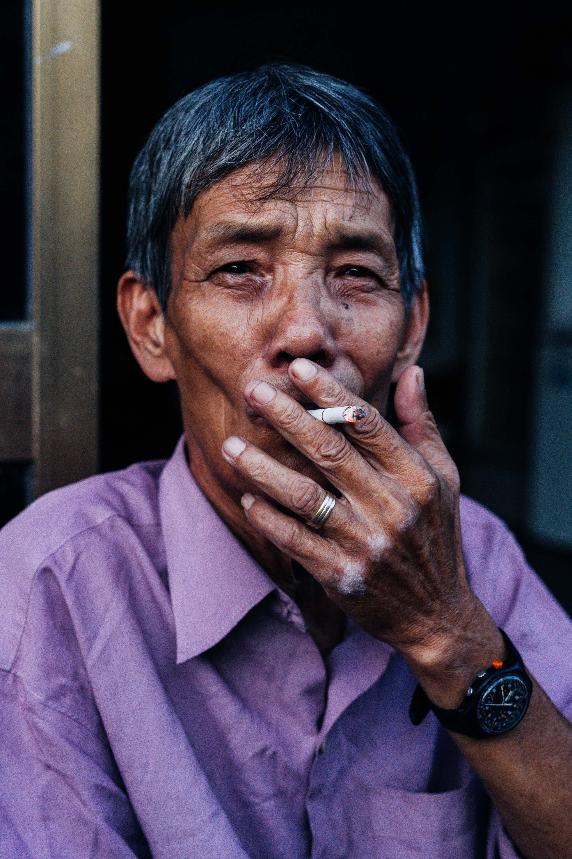 Portrait of a Vietnamese Man Smoking  - Greg Mionske - Advertising and Editorial Photographer in Denver